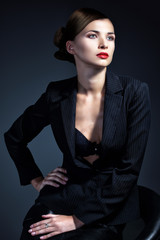 Sexy business woman in a suit. Professional makeup and hairstyle