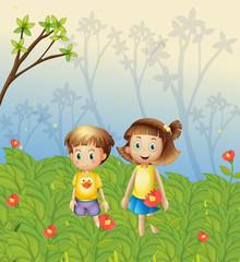 A girl and a boy in the garden