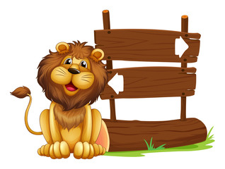 A lion sitting beside a signboard