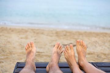 feet are on the beach