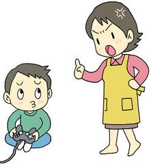 ゲームをする子供を叱るお母さん