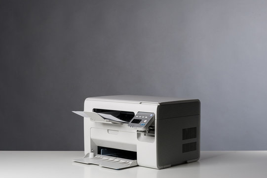 Laser printer isolated on grey background.
