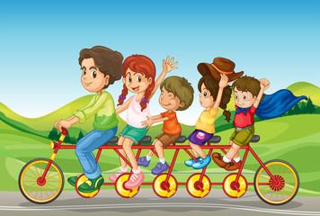 Poster Regenboog Kids riding a bicycle