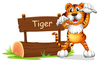 A tiger standing at the right side of a sign board
