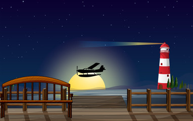 A light house, an airplane and a sea