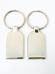 A pair of metalic trinket keychain isolated on white background