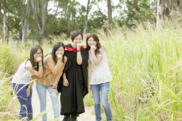 Asian friends in graduation