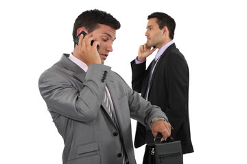 Two businessmen over the phone.