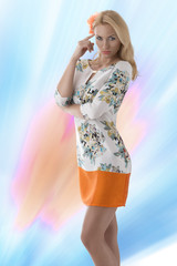blonde clothing dress with floral pattern abd finger near the te