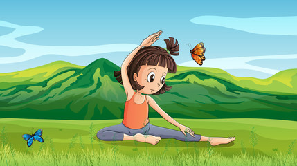 A girl doing yoga near the hills
