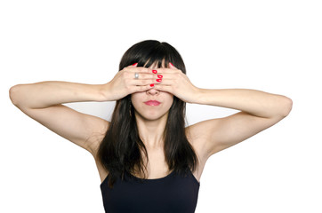 Portrait of young beautiful woman covering her eyes