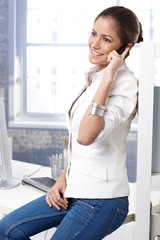 Pretty casual business woman on phone