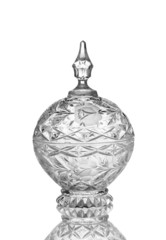 Ornamental glassware bowl with reflection on white background.