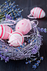 Easter eggs in a nest on a vintage background