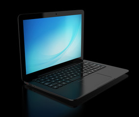 black laptop on the black background
