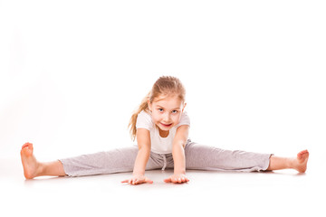 Beautiful girl gymnast  exercising, stretching