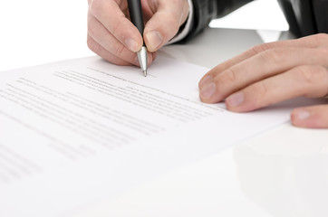 Closeup of a man signing a contract