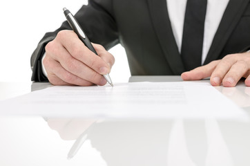 Front view of a business man signing a contract