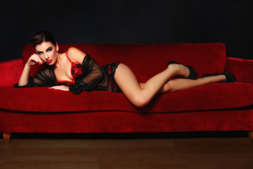 Beautiful Sexy Woman on a Couch
