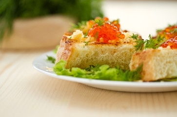 Fried toast with cheese and red caviar