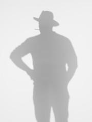 man silhouette smoking a cigarette