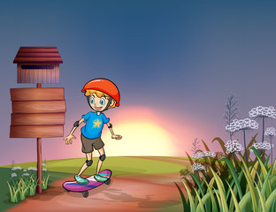A young boy skateboarding in the hills