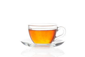 Cup of tea with saucer on white background