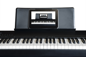 Electric piano with tablet PC and diminishing picture