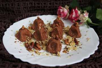 Homemade truffles with walnut in white plate