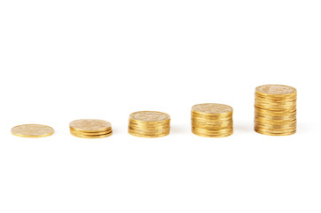 Columns of golden coins isolated on white background
