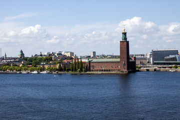 Old city skyline on blue water under blue sky