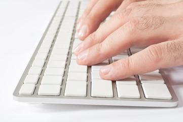 Finger pressing a computer key