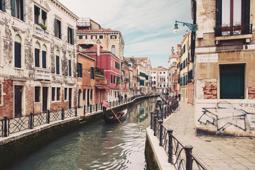 Typical canal with gondola. Venice, Italy.