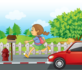 A girl running in the street