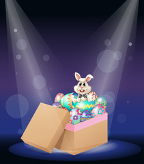 A bunny inside a box full of easter eggs