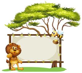 A lion and a bee near a big tree