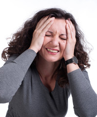 Young woman suffering from a terrible headache
