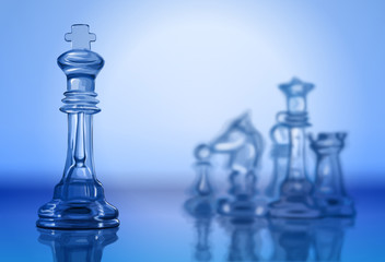 Transparent chess pieces on the mirror surface
