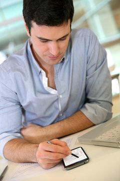 Businessman at work using smartphone