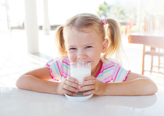 child with a glass of milk