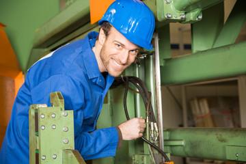 Engineer repairing a machine
