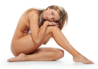 Healthy naked woman with perfect body over white.