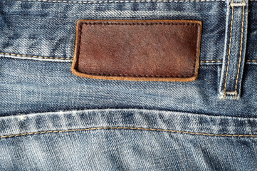leather label on blue jeans