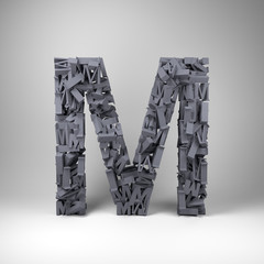 Letter M made out of scrambled small letters in studio setting