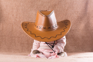 Sweet sleeping baby in a cowboy hat