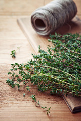 Bunch of fresh thyme on wooden board