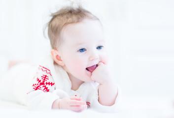 Funny adorable little girl sucking on her finger
