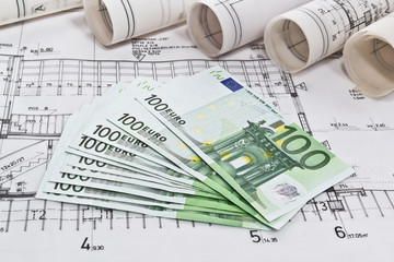 Finance euro money with architectural blueprints