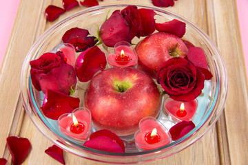 Heart candle with apple and rose petals