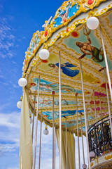 Carousel's ceiling with blue sky.